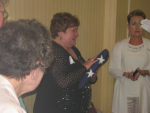 Robin Perdue receiving the Flag